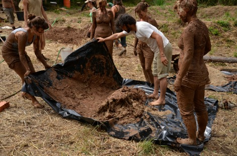 Preparing a dense mud mix for the inside layer of the Cob Oven