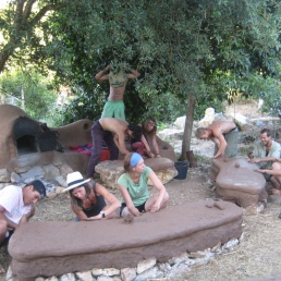 building cob benches for the outdoor social space