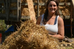 june carrying a straw bale