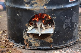Burning sticks in a rocket stove