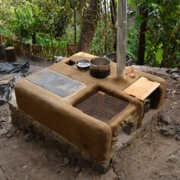 Rocket Stove kitchen with griddle, multi-pot stove and grill. Guatemala 2013