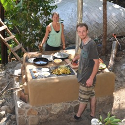 """While Jeremy is cooking, I am giving the whole stove an additional protective layer called """"aliz"""", a natural based color made with wheat paste, fine sand and clay."""